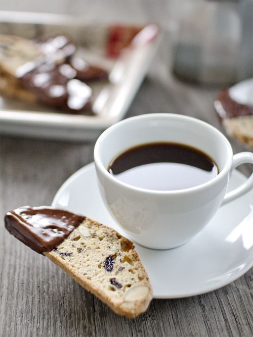 Sour Cherry and Cocoa Nib Biscotti, dipped in chocolate for a decadent afternoon treat with coffee.