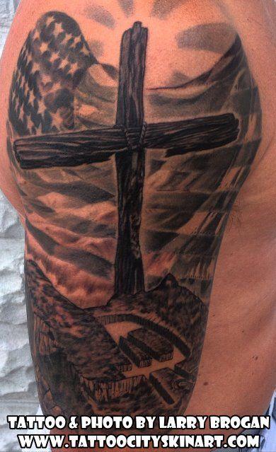 9f8f0628c2d20 wood cross with American flag, black and grey half sleeve tattoo by Larry  Brogan Tattoo City Skin Art. Lockport, IL www.tattoocityskinart.com