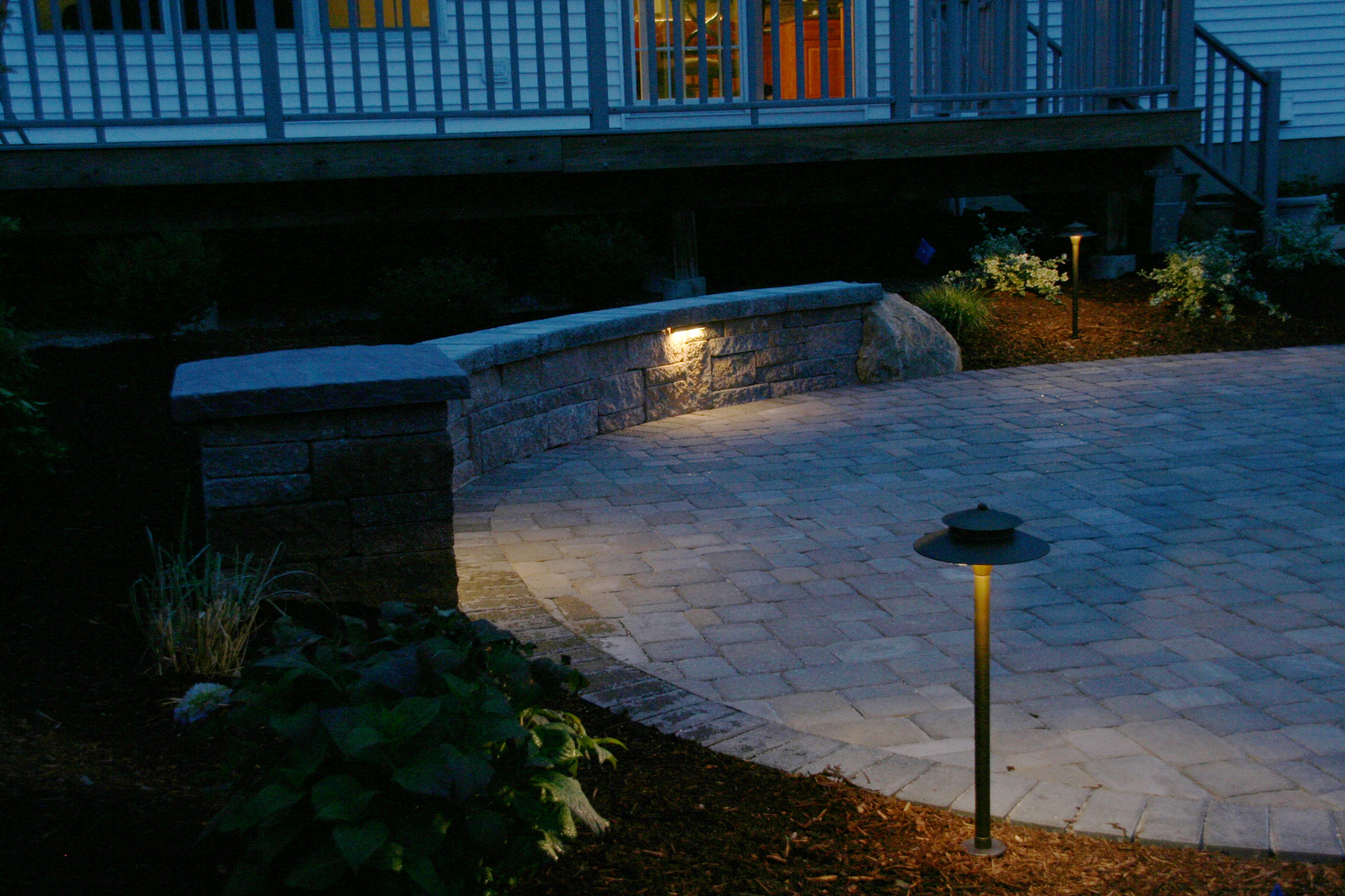 Under Cap Landscape Lighting And Area Lights Illuminate A Paver Patio And Sitting Wall By Bahler Brothers Landscape Lighting Area Lights Paver Patio