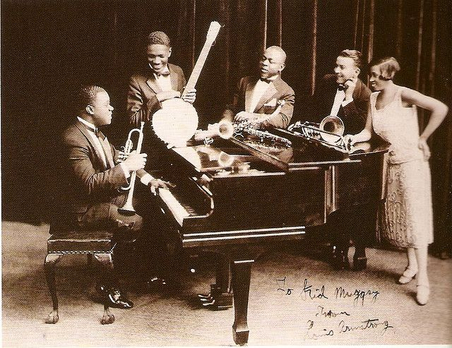 Louis Armstrong's Hot Five  Left to right: Armstrong, Johnny St. Cyr, Johnny Dodds, Kid Ory, and Lil Hardin Armstrong (his wife at the time).