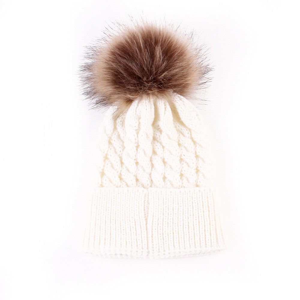 Hit of the season - a childrens hat with a fur pompon