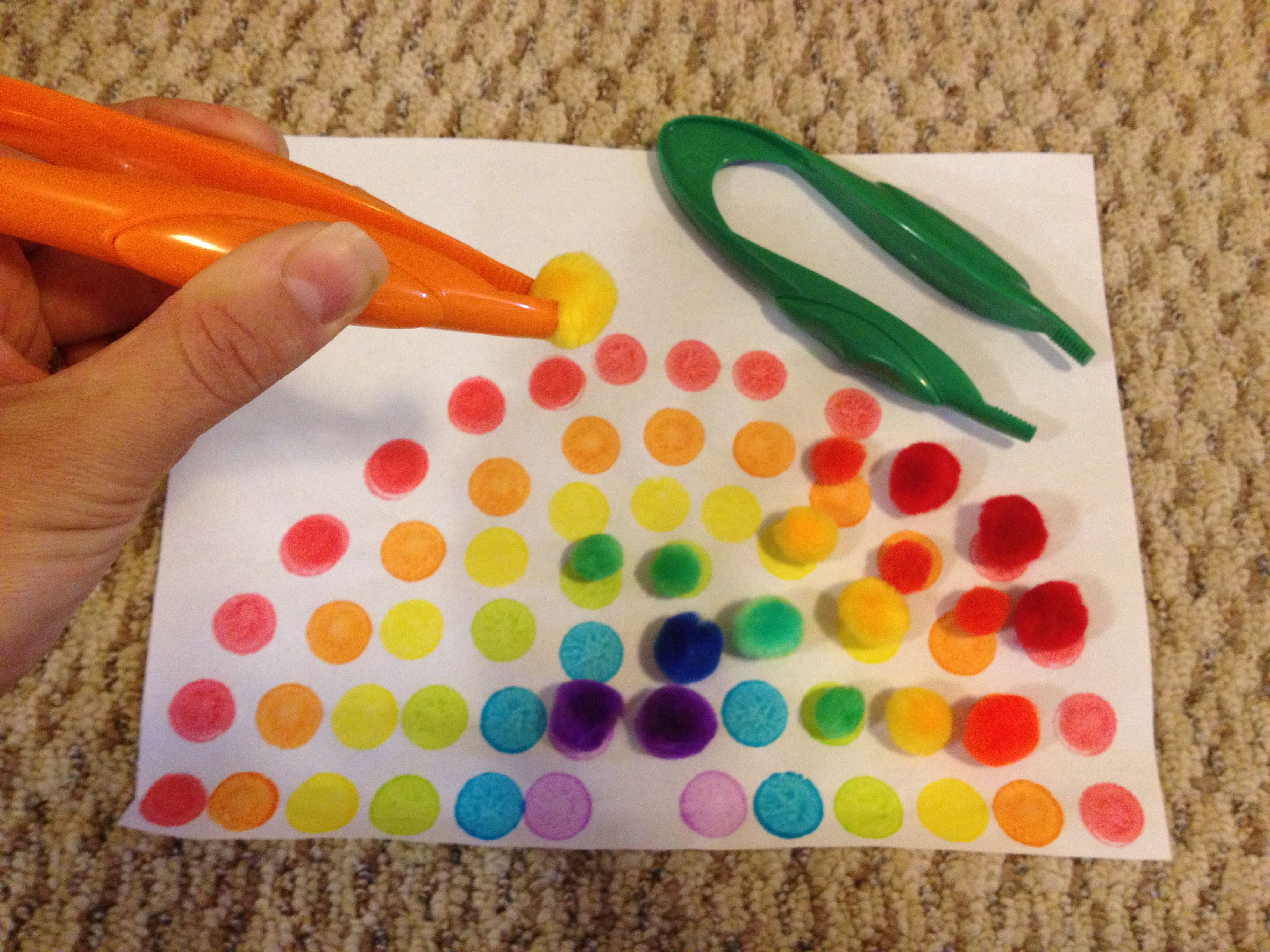 Fine Motor Place Pom Poms On Dotted Rainbow With Tweezers