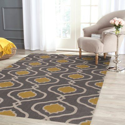 The The Conestoga Trading Co. Gray/Gold Area Rug is the perfect addition to a modern or contemporary home decor. This area rug is made from wool, which keeps it soft and durable for years to come. It sports a beautiful combination of grey and gold color, which adds a bright and serene look to your room. This hand woven rug features a bold and trendy geometric pattern that adds to its visual appeal. This Gray/Gold Area Rug from The Conestoga Trading Co. is available in multiple sizes...