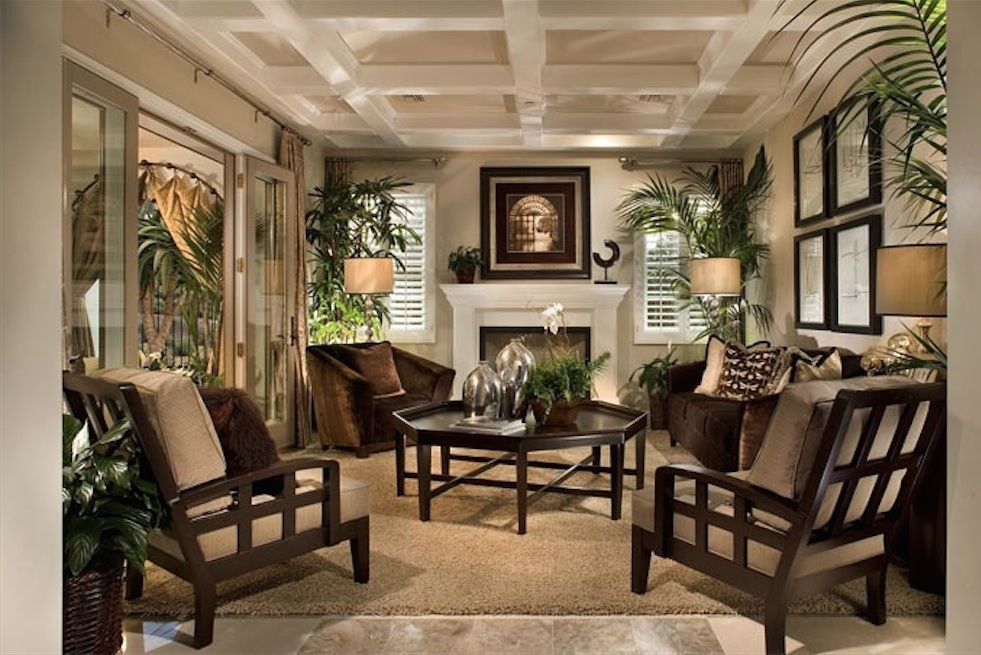 Green British Tropical Colonial Living Room   Dark Couch And Rug