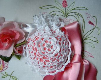 Crochet wedding favor bag with a romantic white Rose of