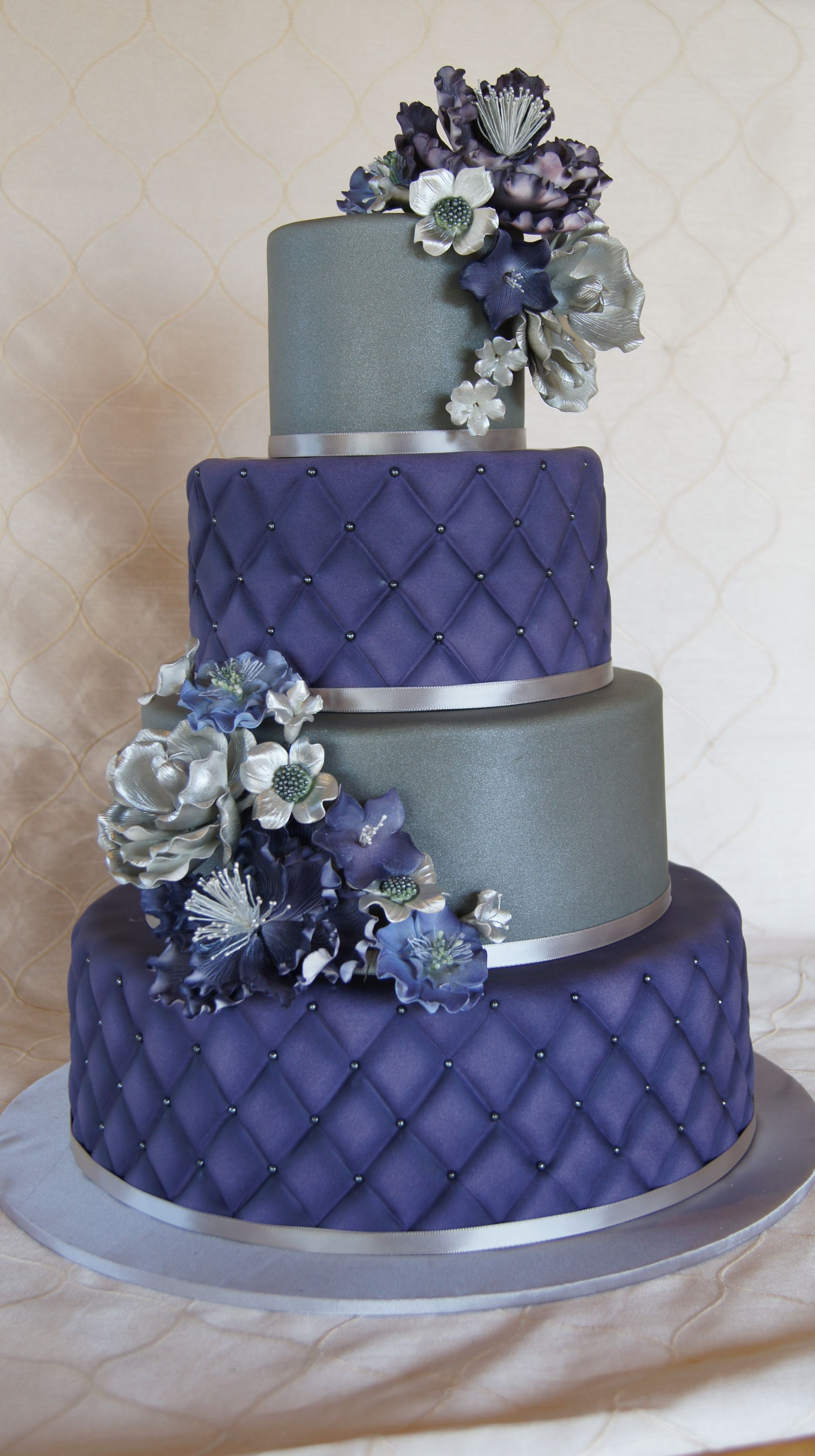 Tiered Purple And Silver Wedding Cake With Quilted Design And