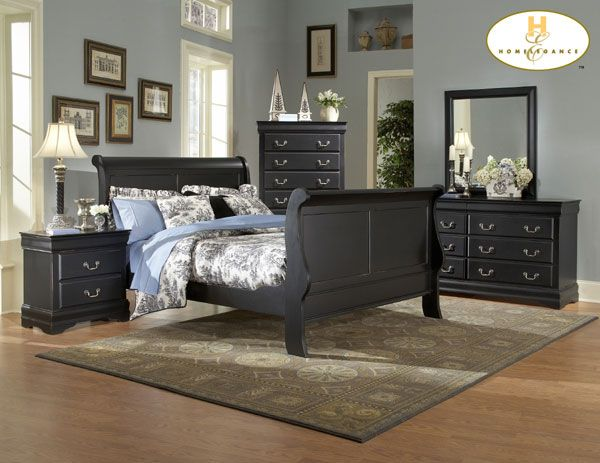 black furniture with blue bedding