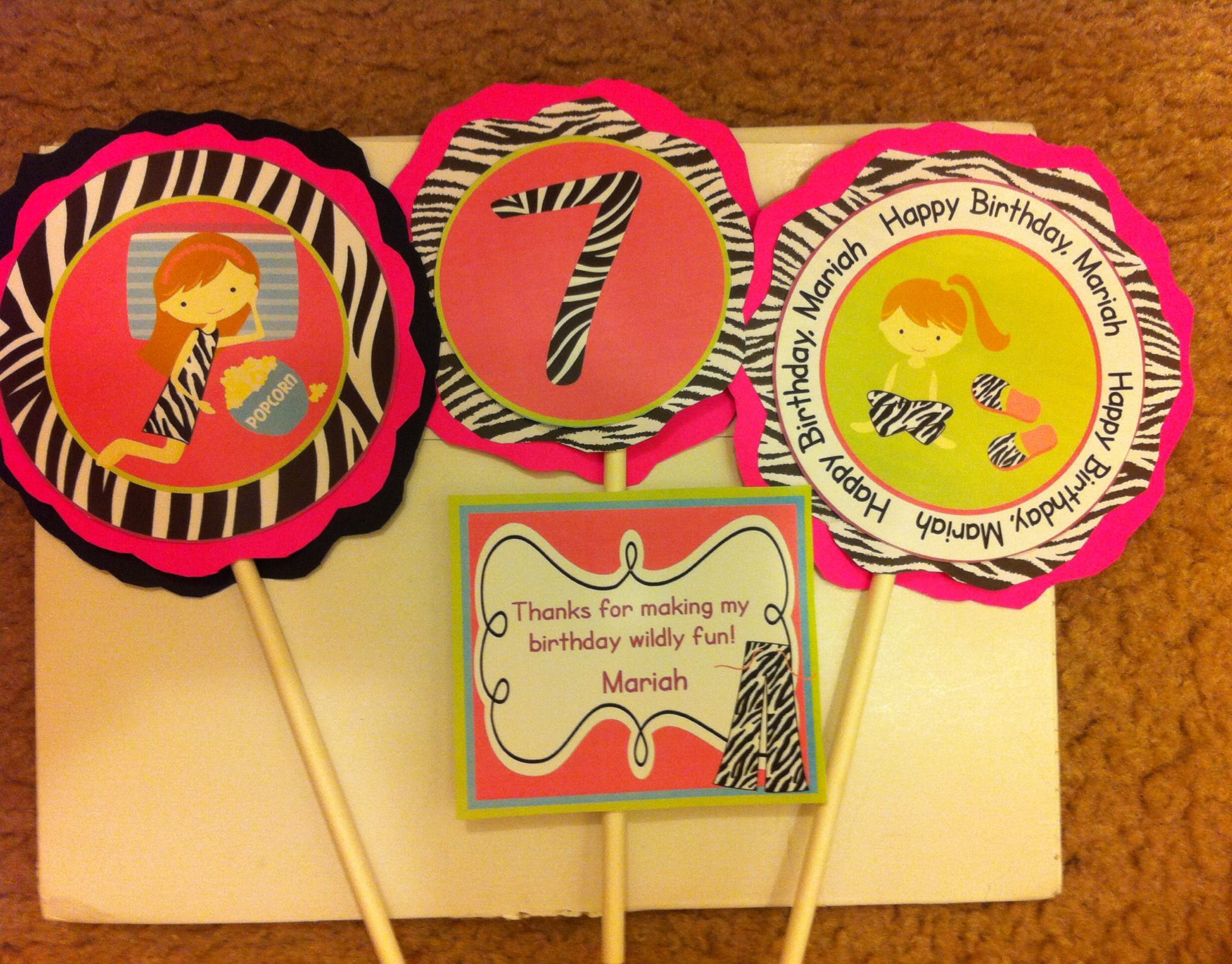 Birthday party decor for a pink zebra theme party Table toppers