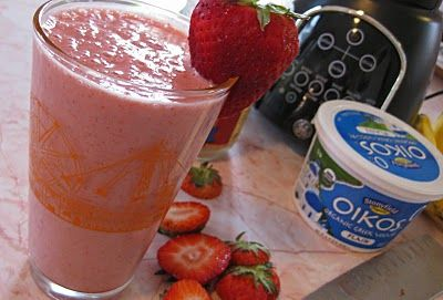 smoothie has strawberries, banana of course, greek yogurt, a little ice, wheat germ and a splash of OJ.