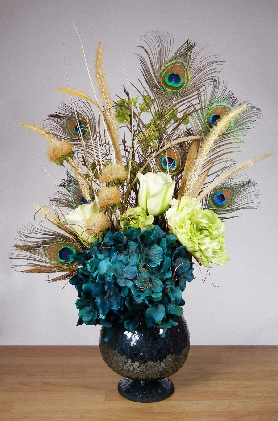Teal blue and green peacock feather hydrangea floral arrangement teal blue and green peacock feather hydrangea floral arrangement in crackled vase 8900 via reviewsmspy