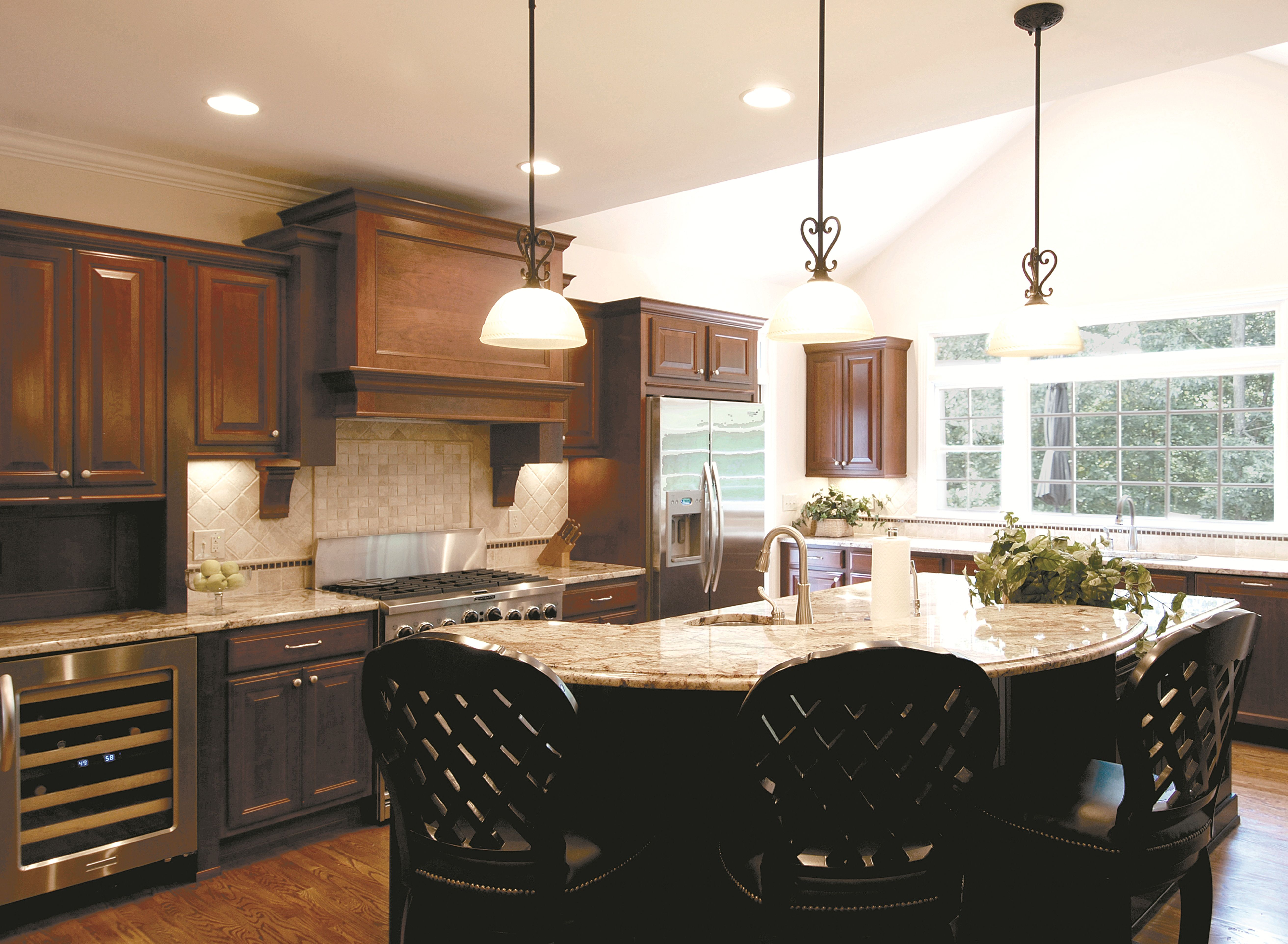 A Lovely Cherry Kitchen With An Island In The Center Is Great For Entertaining Or Breakfast Cabinets And Countertops Quality Kitchen Cabinets Wellborn Cabinets