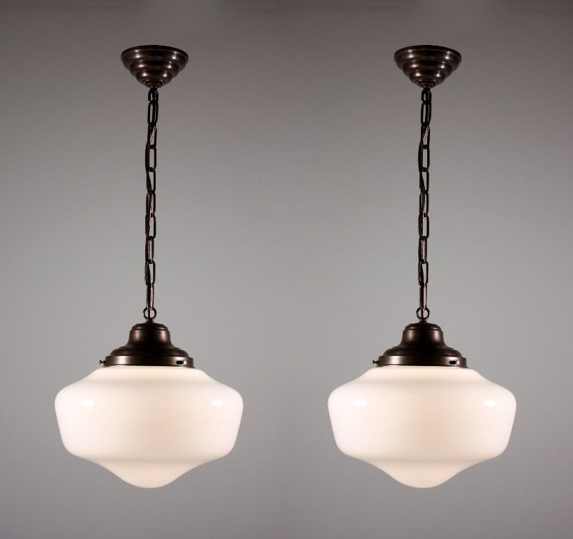 two matching antique schoolhouse lights with glass globes kitchen