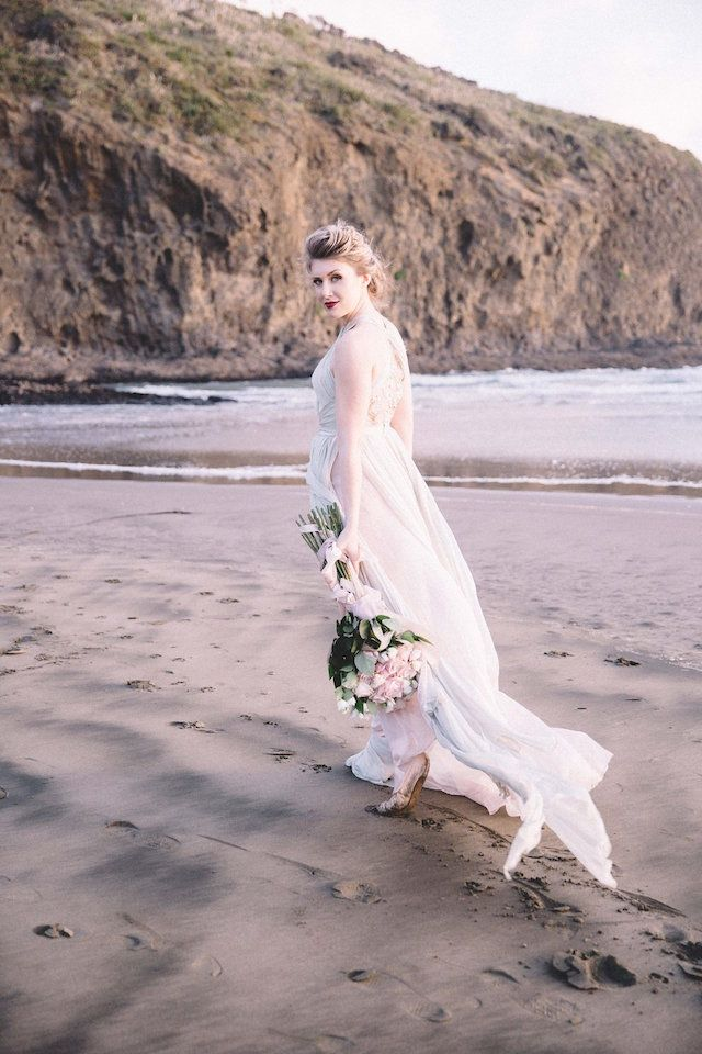 Ballet bride with long stem rose bridal bouquet | Captured By Keryn | see more on: http://burnettsboards.com/2016/02/dramatic-romantic-ocean-cave-ballet/