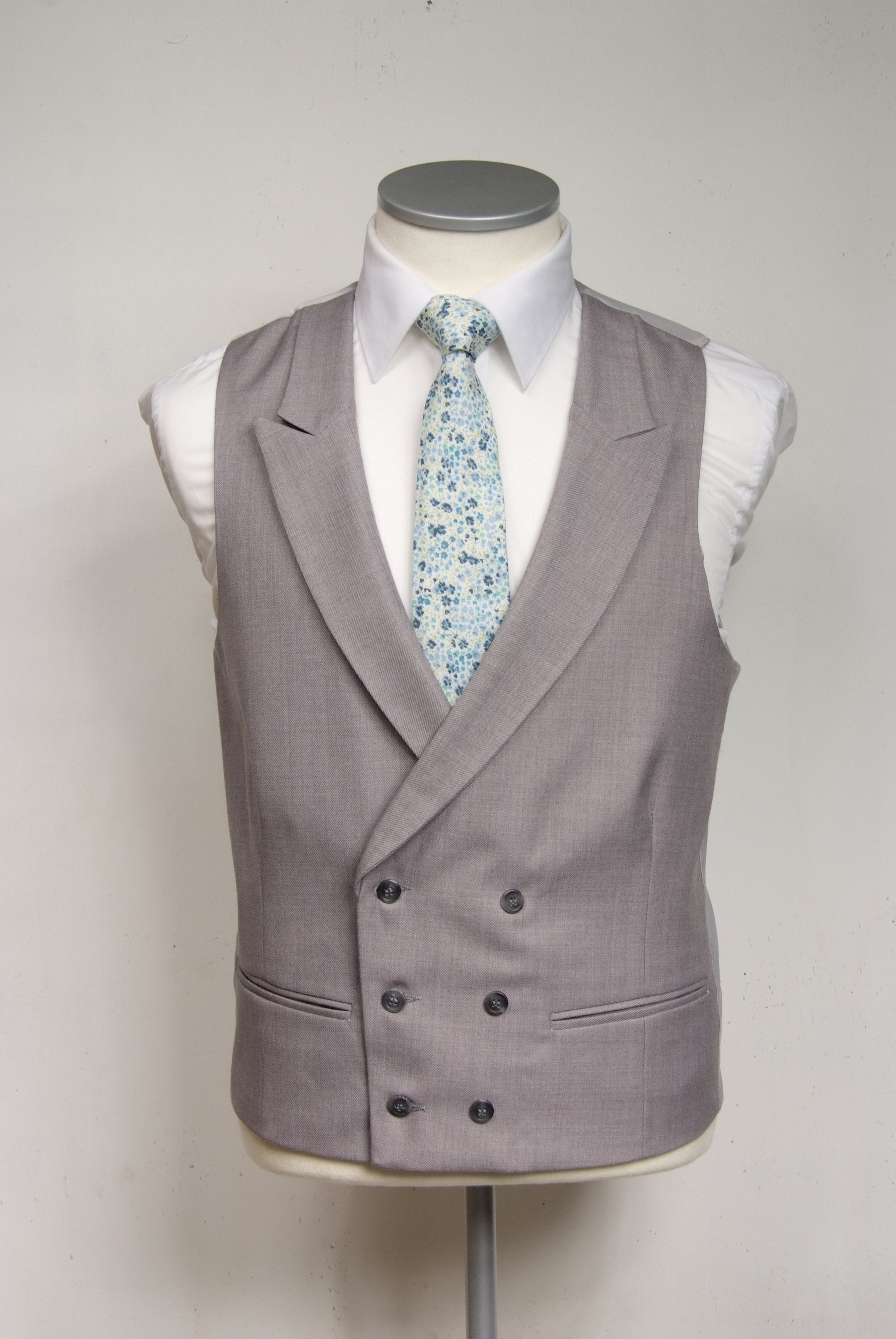 Blue liberty floral print tie £39.50 with grey double breasted waistcoat  £90.00 #groom