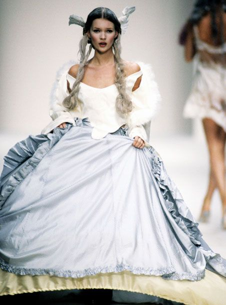 'Kate storming the runway in crinolines.' for John Galliano, Spring 1994