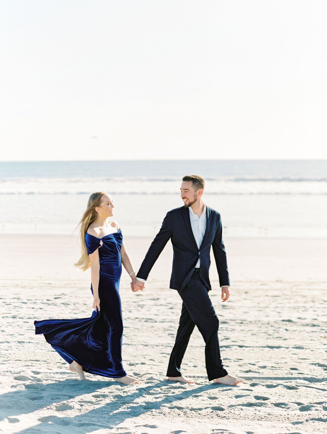Elegant Coronado Island Engagement Photos on the Beach -  Bride in navy velvet gown and groom in suit. Elegant Coronado Engagement Photos on the Beach on fil - #Beach #Coronado #elegant #Engagement #EngagementPhotosafricanamerican #EngagementPhotosbeach #EngagementPhotoscountry #EngagementPhotosfall #EngagementPhotosideas #EngagementPhotosoutfits #EngagementPhotosposes #EngagementPhotosspring #EngagementPhotoswinter #EngagementPhotoswithdog #Island #Photos #summerEngagementPhotos #uniqueEngagem