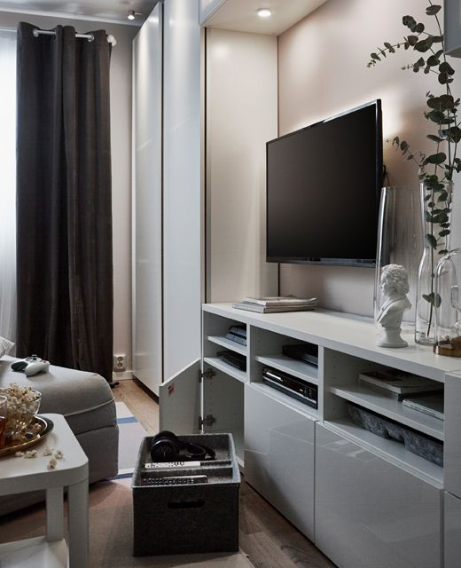 An Entertainment Center Is Set Up With Open And Closed Storage, Interior  Organizers And A Larger TV.
