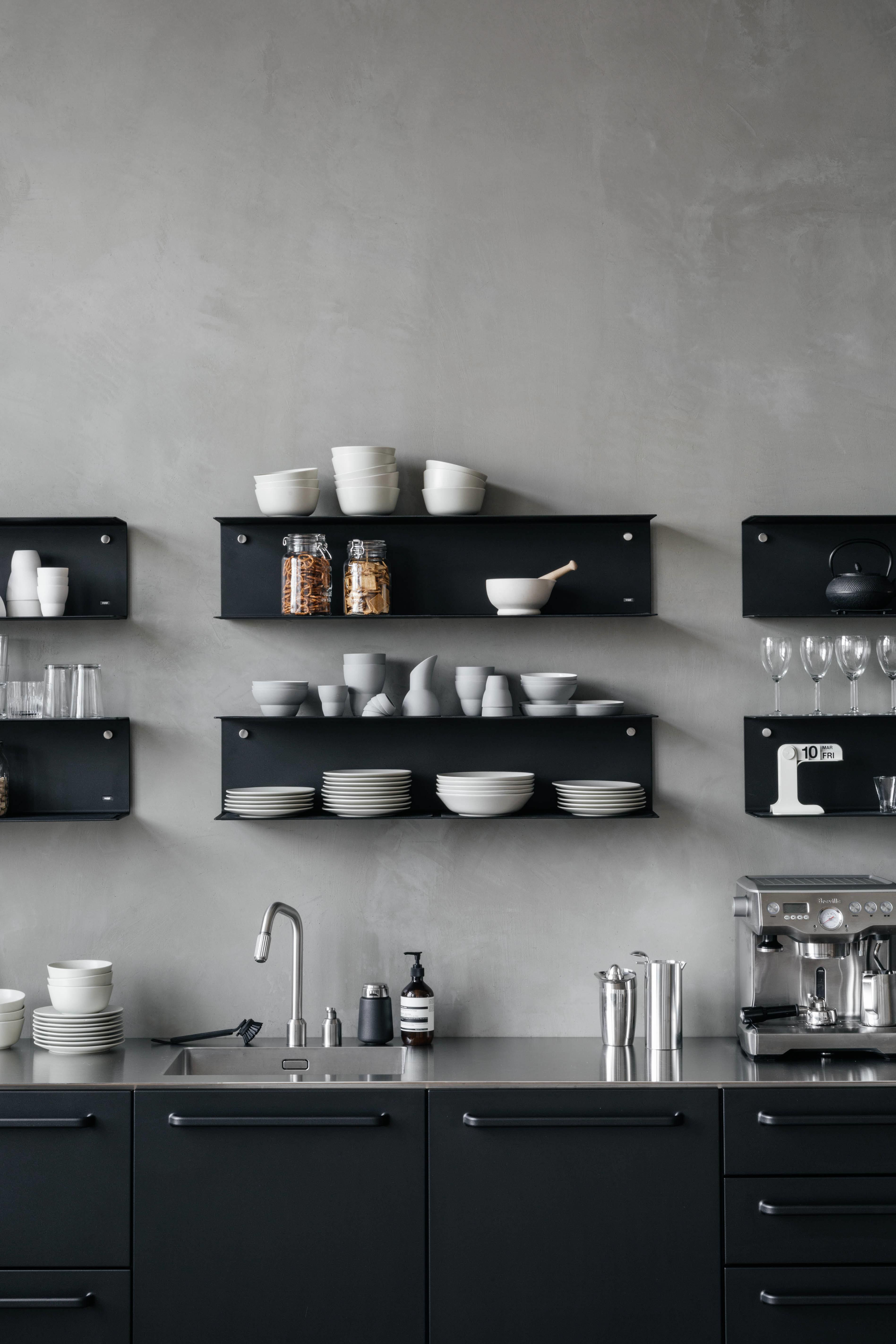 Black Modular Kitchen From Vipp With Matching Shelves On Conrete