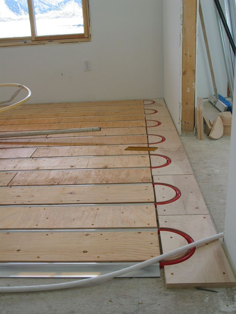 How To Install A Radiant Heat System Underneath Flooring Hydronic Radiant Floor Heating Heating Systems Radiant Heat