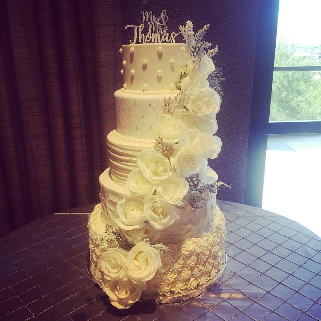 Five tier pearl quilted ruffled with real floral accents wedding