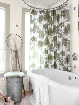 Guest Bedroom Cottage - House of the Year 2012 - Country Living- the tree fabric shower curtain is hung facing the tub. a shower/free standing tub set up.. perfect.