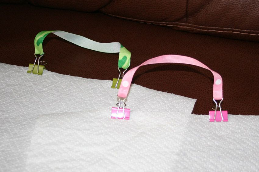 DIY Bib clips. Stash in a diaper bag to turn a paper towel, napkin or hand towel into an impromptu bib