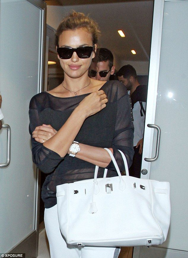 Added extras  The 28-year-old ported a large Hermes Birkin bag which matched  with her white watch bc5bcf446d0b9