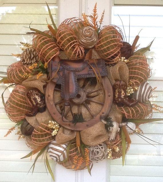 Photo of Items similar to Saddle and Wagon Wheel Burlap Wreath on Etsy
