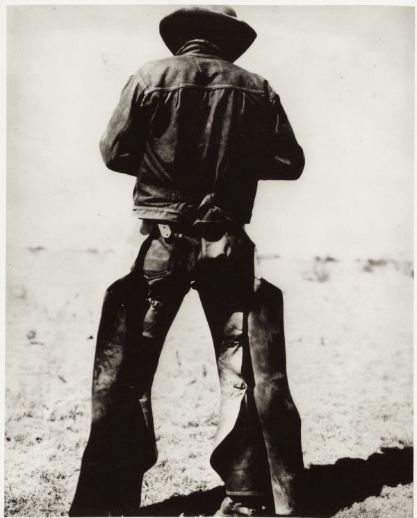 "78402331fb0 circa 1934– ""Rear view of a man wearing chaps and spurs"" –Photo McCormic  Co."