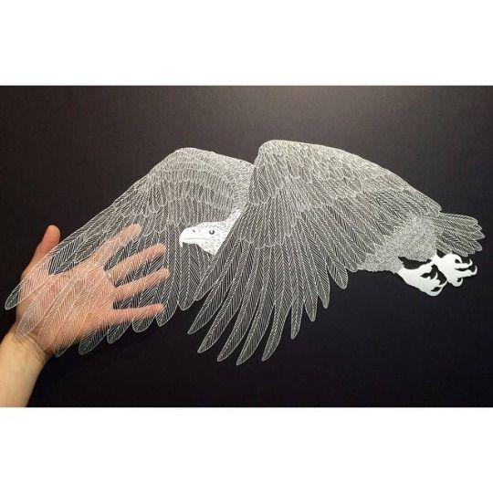 Handcut paper art by Maude White.