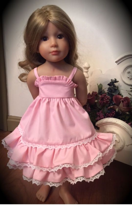 This is a sundress I made for my Kidz 'N Cats doll. The pattern was inspired by Jenwrenne's pattern for a sundress for tiny dolls.