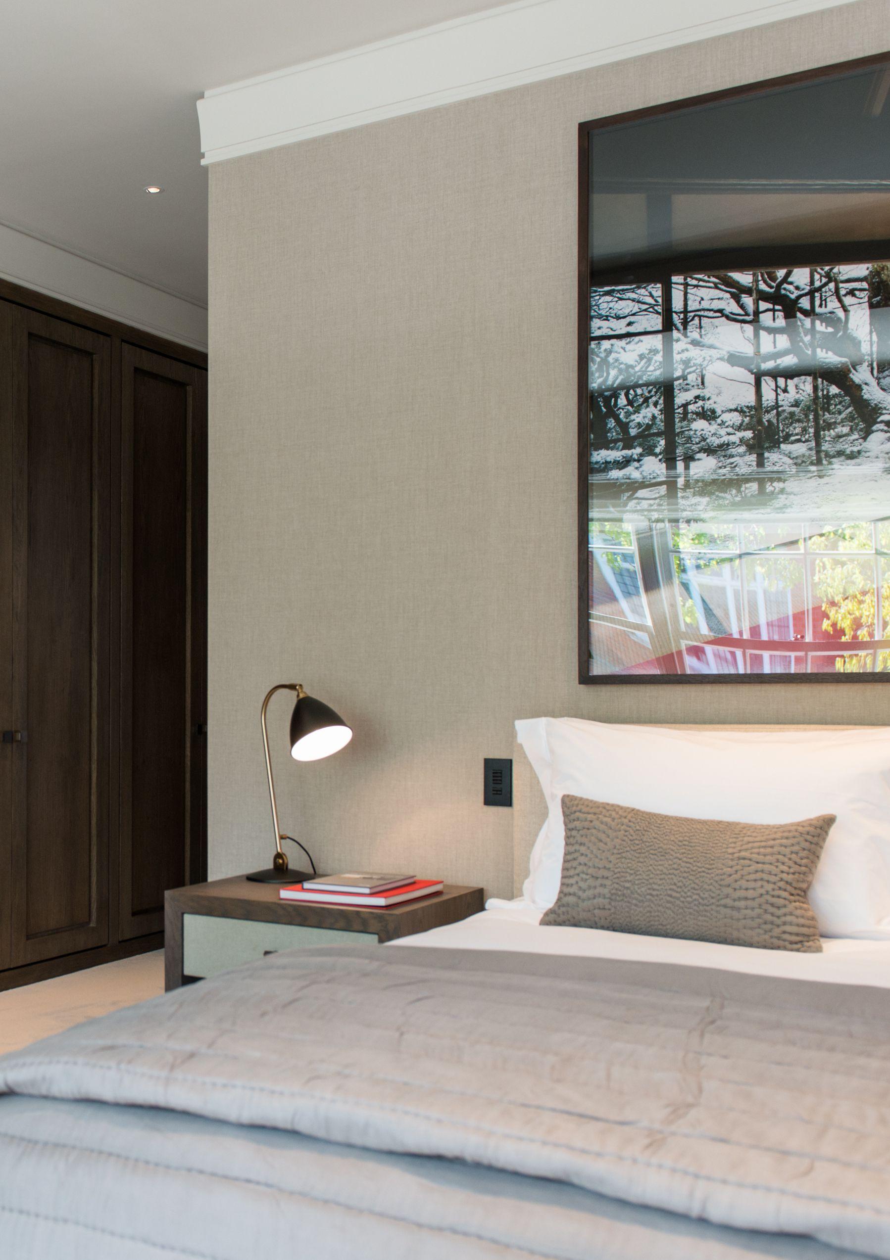 Stylishly simple modern bedroom in dark timber