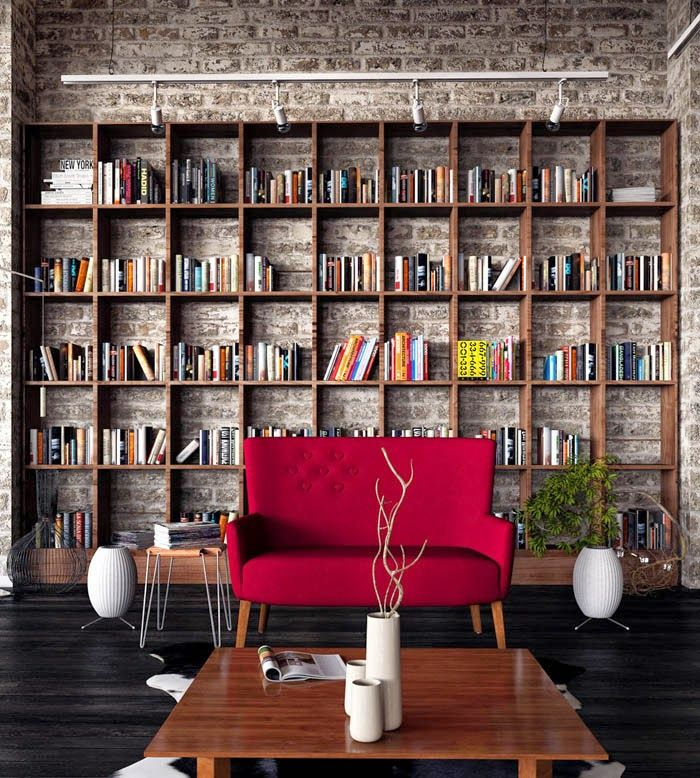 Brick accent wall bookshelves and comfy focal