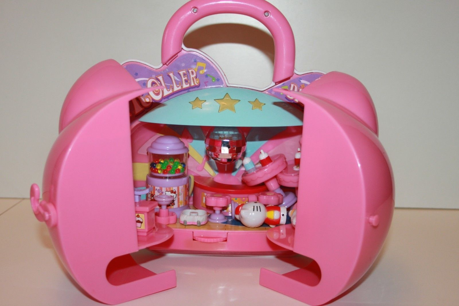 Blue box hello kitty roller disco carry along play set and