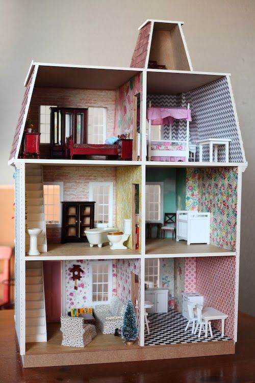 build a diy dollhouse from hobby lobby. wallpaper is scrapbook paper