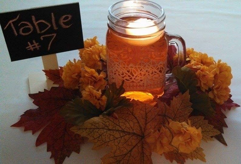 Simple autumn wedding table number setting with floating candle and florals - Distinctive creations