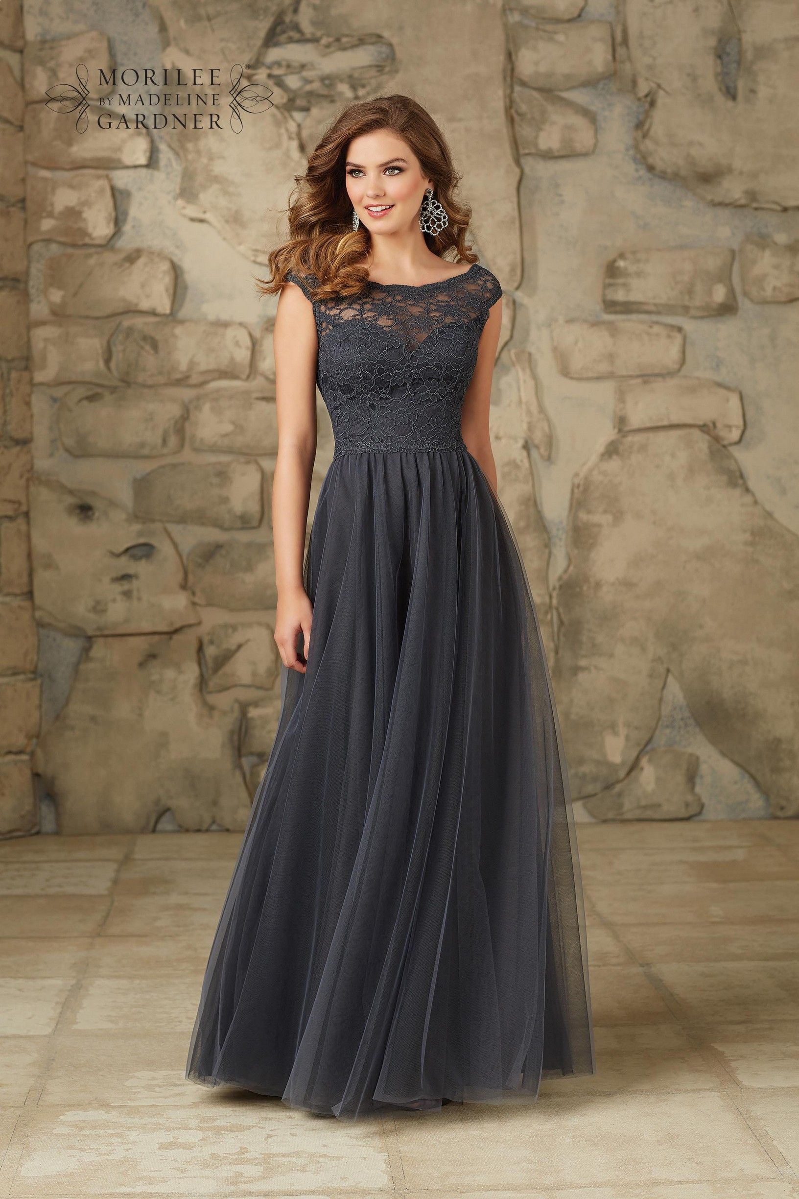 A capped sleeve lace bodice with plunge back on a full length tulle