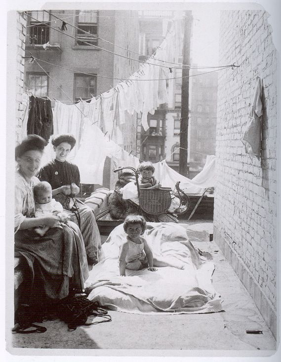 Lewis Wicker Hine  -   A tenament family gets fresh air on a hot day. New York, ca. 1910.