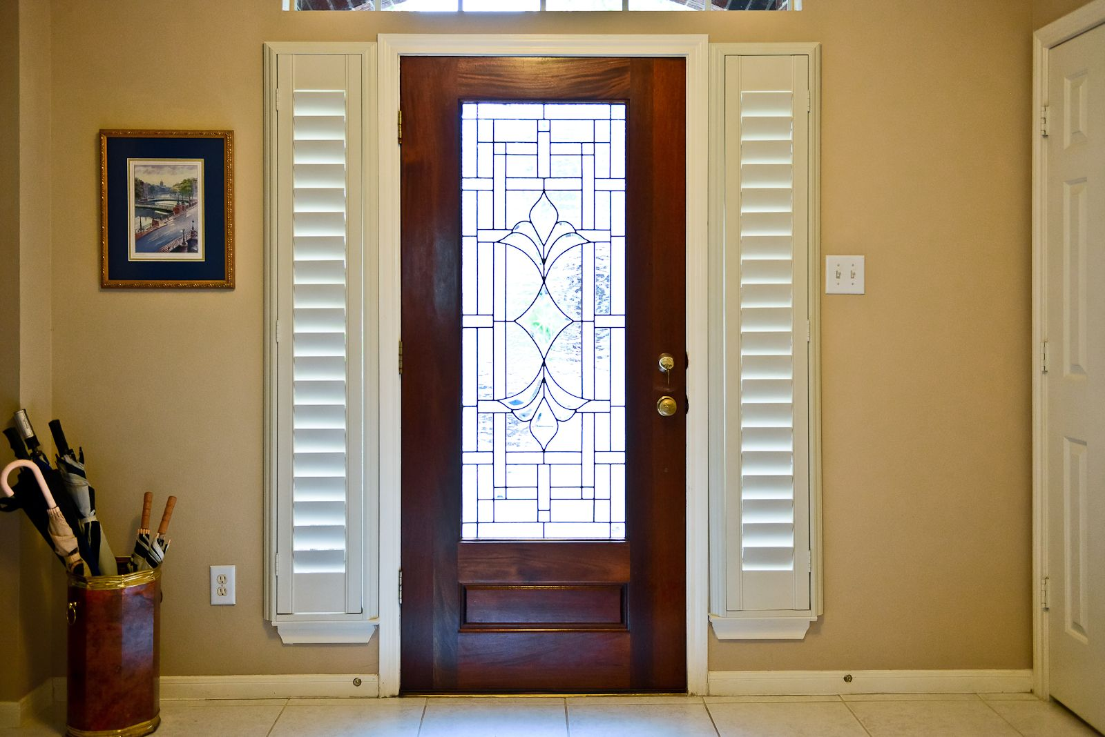 Plantation Shutters On The Sidelight Windows By The Front