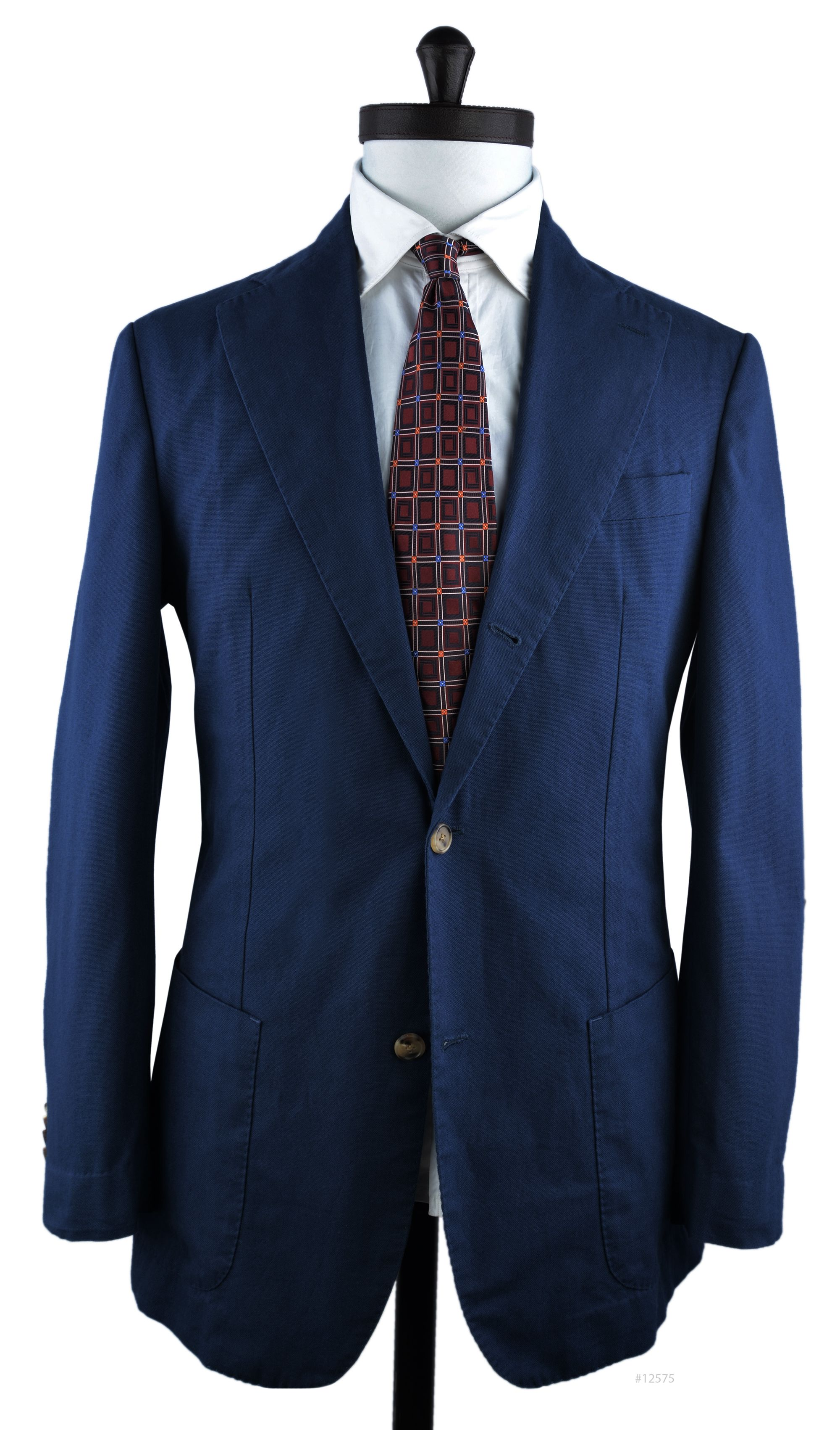 Luxire casual unstructured summer jacket constructed in   Brisbane Moss Navy Canvas: http://luxire.com/products/brisbane-moss-navy-canvas  Details: 3-2-roll button style with notch lapel.  Welted breast pocket and hip patch pocket.  Sleeve opening: Kissing, functional light brown horn buttons.