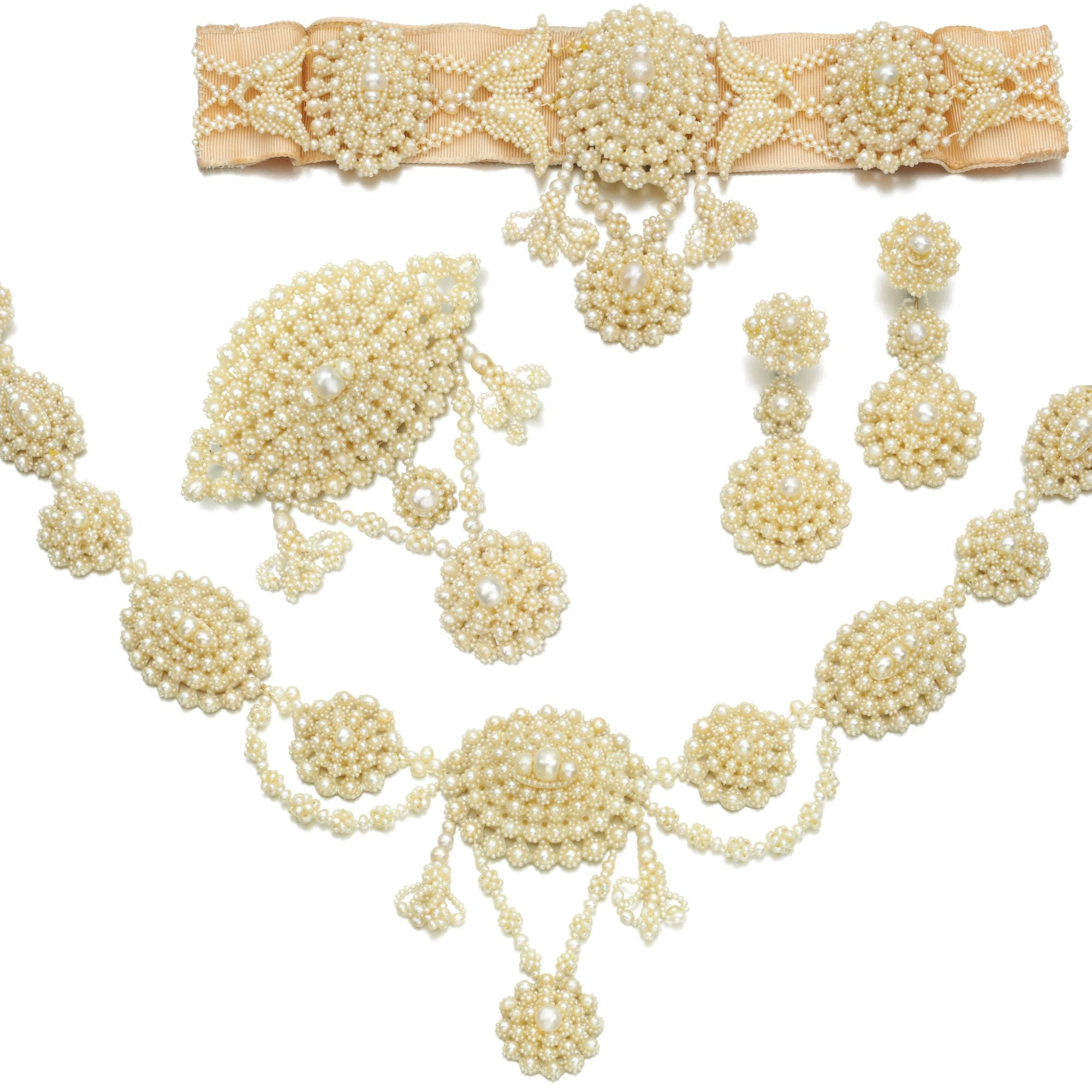 d887acfb7 Seed pearl parure, Tiffany & Co., 1850s Comprising: a necklace, brooch,  pair of pendent earrings and a collier, each composed of oval seed pearl  clusters ...