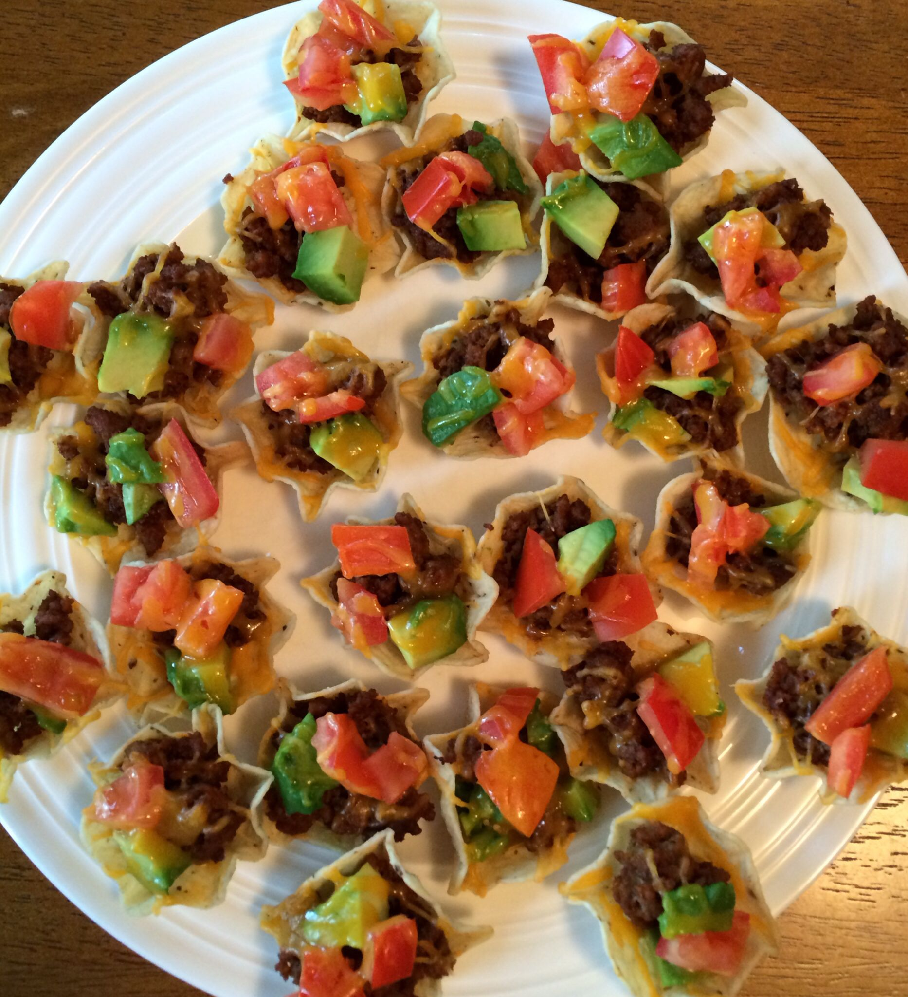 Simple taco bites. Chips+taco meat+tomato+avocado+cheese. Bake at 350 for 4 min add a bit of sour cream and have a light dinner or great appetizer. Mexican dish