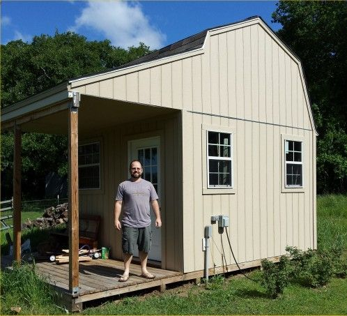 this awesome backyard storage shed is a 12x12 gambrel roof with side porch