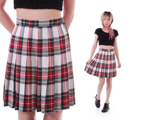 837809d2be This adorable 1990s vintage pleated high waist tartan plaid skirt in red,  white, navy blue, forest green, black and yellow is perfect for any