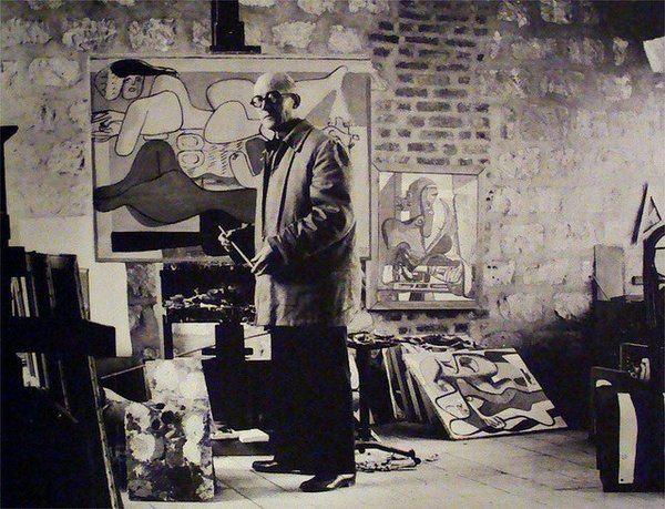 Le Corbusier in his studio.
