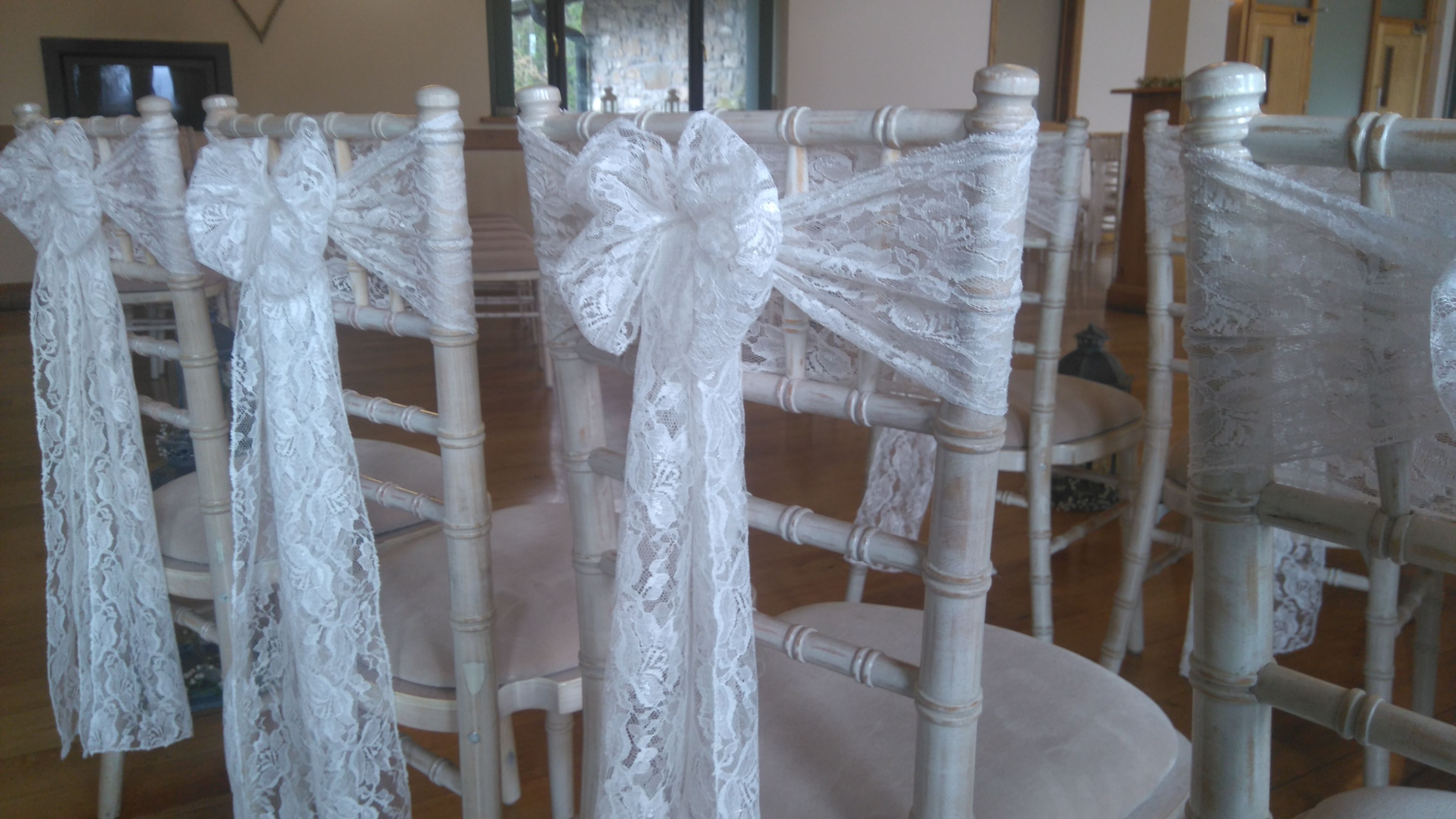 Lace sashes tied in a bow Canada lake Lodge Chiavari chair hire