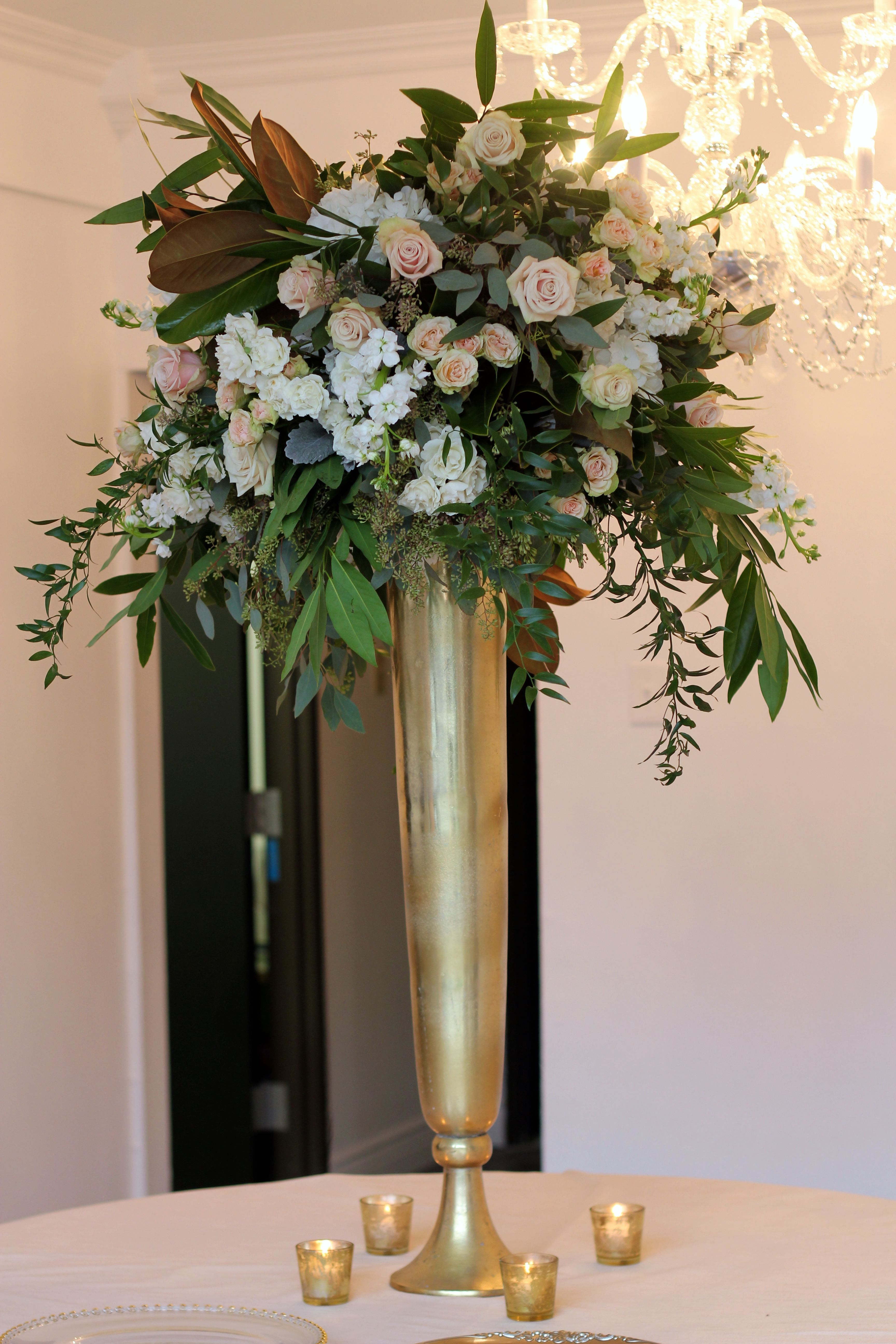 The altar will feature two large textured arrangements made of option for tall arrangements with magnolia greenery white and peach flowers clear glass trumpet vase instead of gold vase reviewsmspy