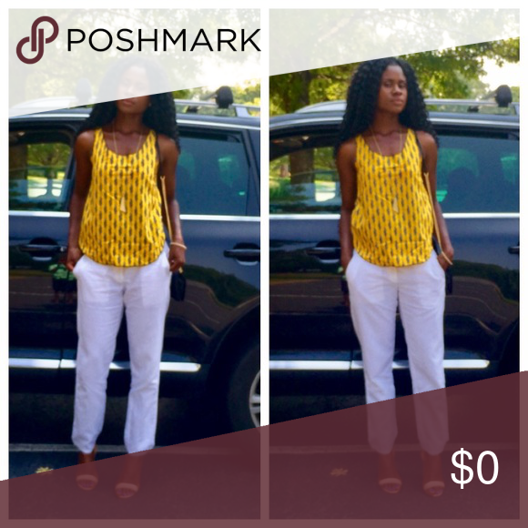 Gap paired with African prints Gap white skinny legs pants paired with yellow sleeveless African print top Tops