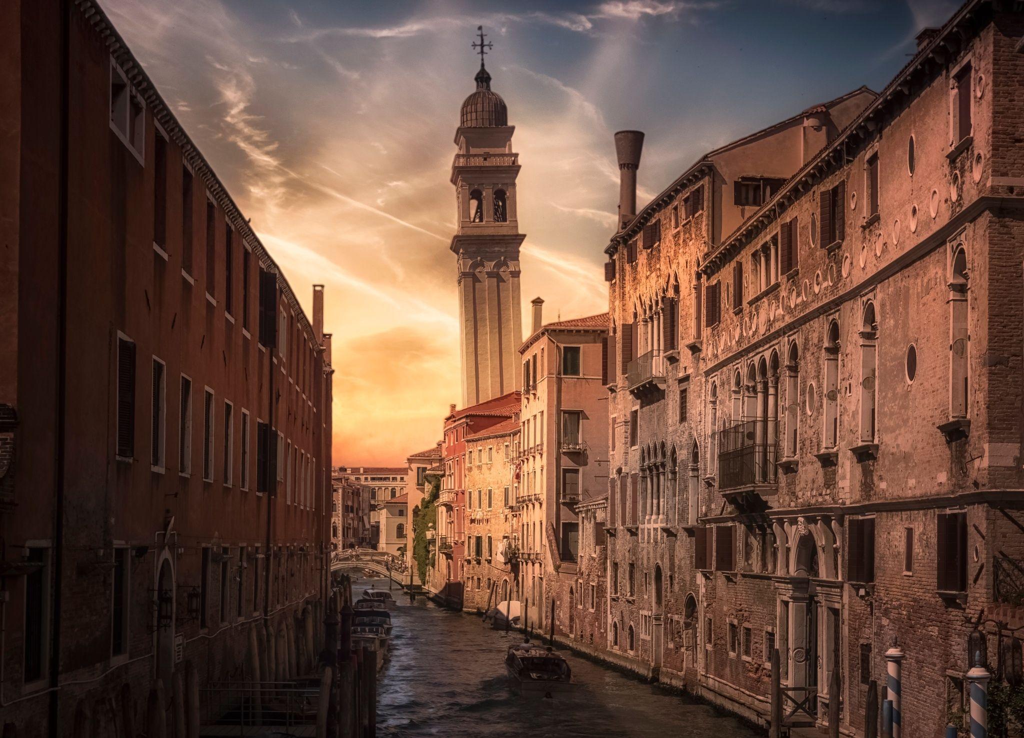 Rio de la Pleta - The canal Rio de la Pleta in Venice with the tilted tower of Church of Sant' Antonin in the background.
