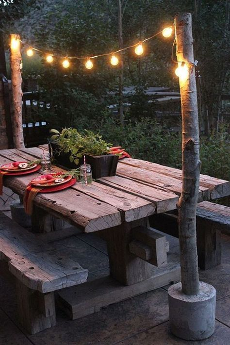 Make these diy string light poles to create a simple rustic overhang for your backyard picnic table